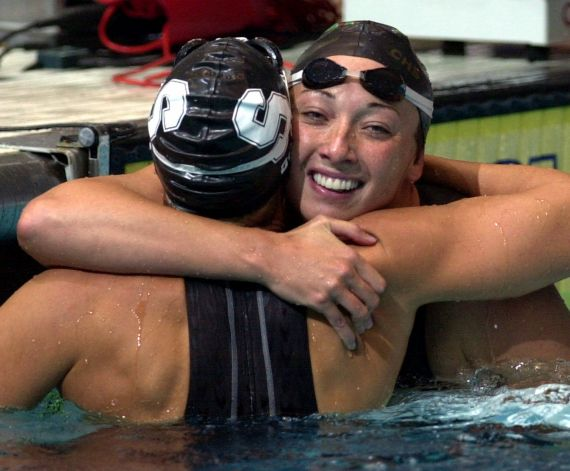 FILE - In this Aug. 16, 2000 file photo, Amy Van Dyken, right, of Lone Tree, Colo., hugs Dara Torres of Palo Alto, Calif., after Torres won the finals of the women's 50-meter freestyle at the U.S. Olympic Swimming Trials in Indianapolis. Six-time Olympic gold medalist Van Dyken has a severed spine after an accident on her all-terrain vehicle in Arizona. A hospital spokeswoman didn't provide details Monday on the injuries. The swimmer was hurt Friday night, June 6, 2014,  and told emergency workers at the scene she could not move her toes or feel anything touching her legs. (AP Photo/Chris O'Meara, File) Photo: CHRIS O'MEARA, Associated Press / AP