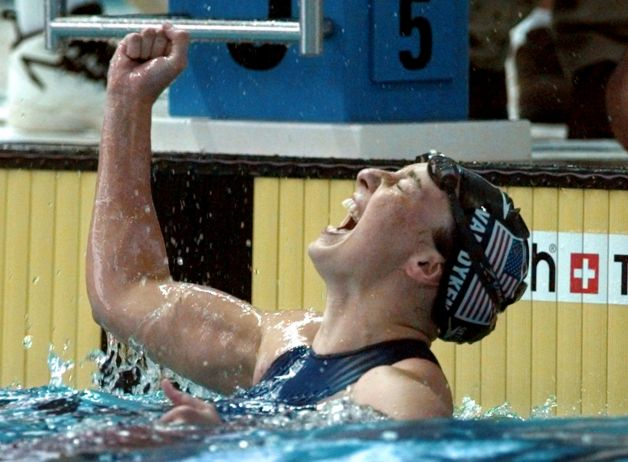 FILE - In this July 26, 1996 file photo, Amy Van Dyken of the United States celebrates after winning the gold medal in the women's 50 meter freestyle at the 1996 Summer Olympic Games in Atlanta. Six-time Olympic gold medalist Van Dyken has a severed spine after an accident on her all-terrain vehicle in Arizona. A hospital spokeswoman didn't provide details Monday on the injuries. The swimmer was hurt Friday night, June 6, 2014,  and told emergency workers at the scene she could not move her toes or feel anything touching her legs. (AP Photo/David Longstreath, File) Photo: DAVID LONGSTREATH, Associated Press / AP