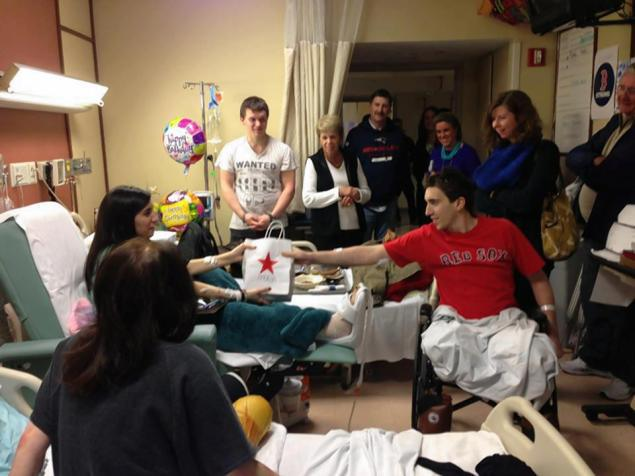 Jeff Bauman Jr., who lost both legs in Boston Marathon bombing, gives birthday present to fellow victim Sydney Corcoran (via NY Daily News, April 24, 2013)