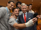 Belgium's King Philippe poses for a selfie with Belgian national soccer players after the team's 2014 World Cup Group H soccer match in Rio de Janeiro