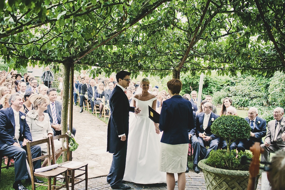 Leanne and Nicholas exchanging vows at Yarlington House. 'I wanted the wedding to feel lush and green and so we chose Yarlington House for its wild gardens and little nooks,' says Leanne. 'Its a bit like a secret garden.'