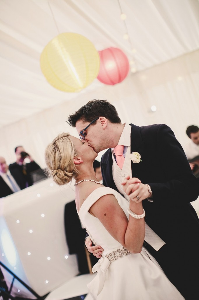 Lianne and Nicholas sharing a kiss on the dance floor.