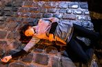 Coronation Street barmaid Tina McIntyre, played by Michelle Keegan, lies dead on the street