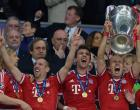 Bayern Munich's Dutch midfielder Arjen Robben lifts the trophy after the UEFA Champions League final football match between Borussia Dortmund and Bayern Munich at Wembley Stadium in London on May 25, 2013, Bayern Munich won the game 2-1 AFP PHOTO / CHRISTOF STACHECHRISTOF STACHE/AFP/Getty Images