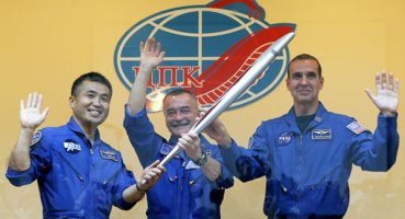 將參與運送奧運火炬至空間站的美宇航員自感幸福