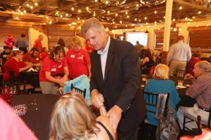 Todd Tiahrt shakes hands with people gathered at his election night party at Villa Luna. Tiahrt is a candidate to represent the 4th District in Congress. (August 5, 2014)