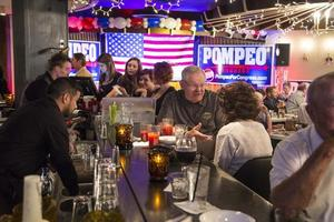 Supporters of congressman Mike Pompeo gather at the Candle Club for the election night watch party in Wichita on Tuesday, Aug. 5, 2014.