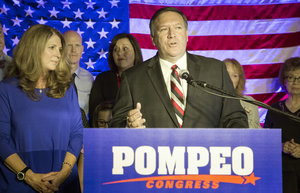 Mike Pompeo, incumbent candidate for 4th District Congress, with wife Susan announces his win over challenger Todd Tiahrt during his election night watch party in Wichita Tuesday, Aug. 5, 2014.