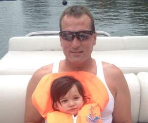 Craig Sytsma, 46, shown with his 2-year-old granddaughter, Leylah Sytsma, died Wednesday evening after he was attacked by a pair of Cane Corsos while jogging.