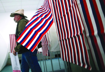 man leaves voting booth