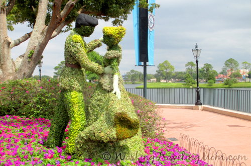 Cinderella and Prince Charming dance at the Epcot Flower and Garden Festival.