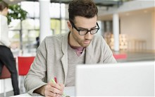 Man using laptop out of office,