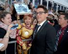 Actor Robert Downey Jr. greets one of his smallest  fans before 'The Judge' premiere during the 2014 Toronto International Film Festival at Roy Thomson Hall Thursday.