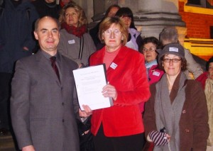 Adrian Winchester and Cllr Maggie Mansell with the Campaign's petition, before it was presented at a Council meeting 30/01/12