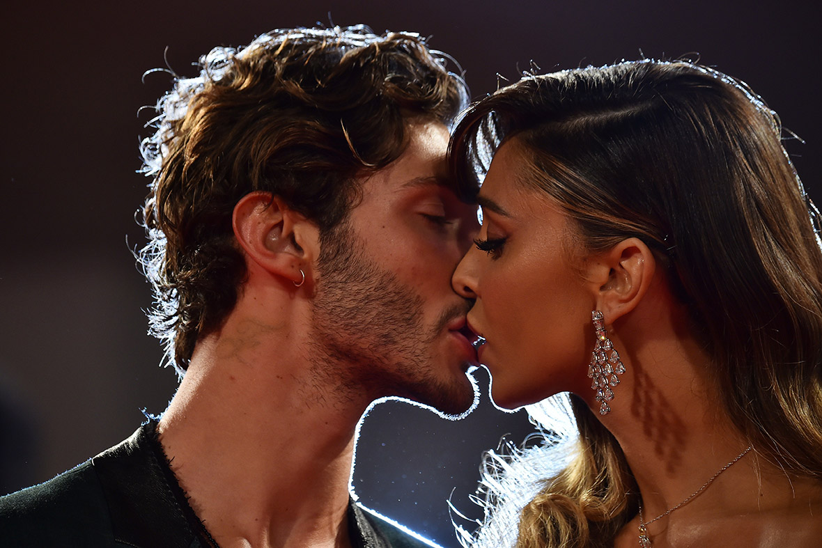 Stefano De Martino and Argentinian model Belen Rodriguez kiss as they arrive for the screening of