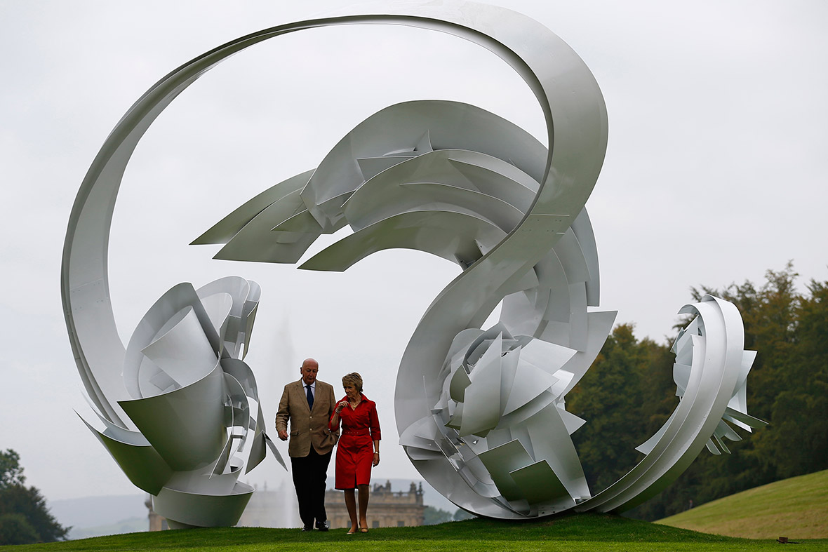The Duke and Duchess of Devonshire walk through a sculpture by US artist Alice Aycock entitled