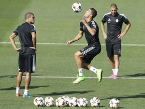 15 September 2014: Real Madrid's Portuguese forward Cristiano Ronaldo (C), Portuguese defender Pepe (L) and French striker Karim Benzema during the team's training session at the Valdebebas sports city on the outskirts of Madrid