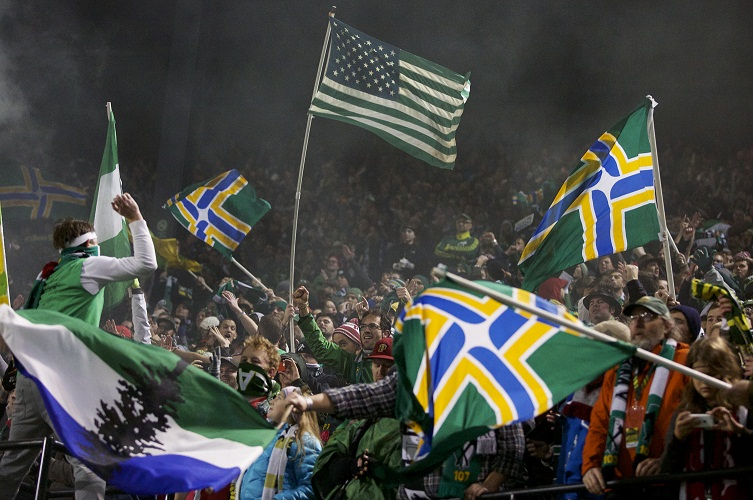 Raucous Timbers fans celebrate a playoff victory over the rival Seattle Sounders.