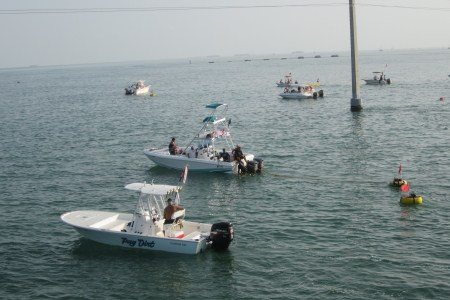 Boats of divers anchored next to the bridge doring the florida keys lobster season.