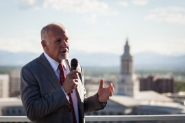 Mac Tully addresses those gathered on the 10th floor of the Denver Post headquarters. (Photo by Kent Meireis, Special to The Denver Post)