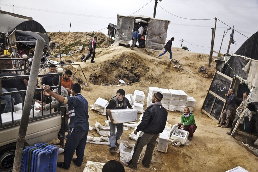 Merchants and restaurateurs congregate at a tunnel that specializes in smuggling in fresh fish from Egypt, packed on ice in Styrofoam boxes. Israel's naval blockade keeps Gazan fishermen close to shore, so seafood is always in demand.