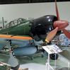 """The restored Zero fighter displayed at Mitsubishi Heavy Industries Ltd.'s Komaki Minami plant in Toyoyama, Aichi Prefecture, is drawing big crowds following the July release of Hayao Miyazaki's animated feature """"Kaze Tachinu"""" (The Wind Rises), a fictionalized biography of the plane's designer Jiro Horikoshi. This photo was taken in August. (The Asahi Shimbun)"""