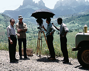 "The author, second from left, with his film crew in the foothills of the Ruwenzoris, or ""Mountains of the Moon."""