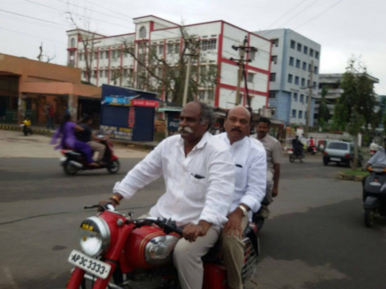 MLA VRK Babu and Minister Ayyana Patrudu seen on bike rushing to effected areas coordinating with officers and volunteers.