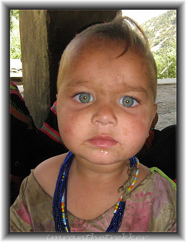 Kalash baby from Romboor, Chitral district in North Pakistan