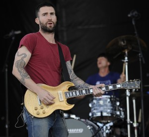 Maroon 5 singer Adam Levine plays with the band before the 137th Preakness Stakes horse race at Pimlico Race Course, Saturday, May 19, 2012, in Baltimore. <span class='credit'>(Nick Wass | The Associated Press)</span>