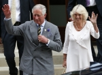Britain's Prince Charles and his wife Camilla, Duchess of Cornwall leave the Lindo Wing of St Mary's Hospital the day after Catherine, Duchess of Cambridge, gave birth to a baby boy, in London July 23, 2013. The world was awaiting the first glim