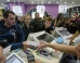 A customer purchases the newly released iPhone 6 in a mobile phone shop in Moscow September 26, 2014. Official sales of Apple's iPhone 6 and iPhone 6 Plus started at midnight on Friday across major cities in Russia, according to local media.