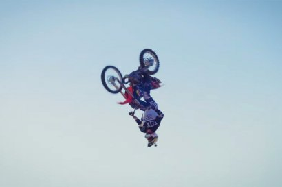 Dirtbike Flips over Stunt Plane