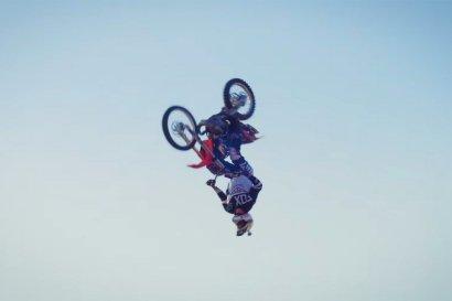 Dirtbike Flips over Stunt Plane