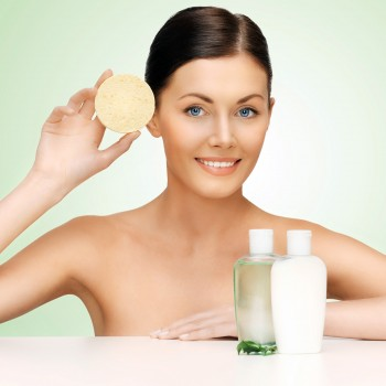woman-cleaning-face-sponge-exfoliating