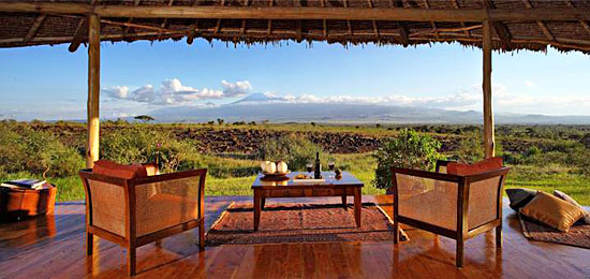 Relax with a meal on deck in the Amboseli National Park.