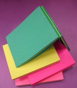 Pads of colored paper.