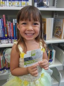 Proud (almost four-year-old) girl with her new library card.