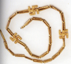 Persian necklace with three swastikas from the first millenium BCE found at Kularaz, in the Gilan region of Iran (National Museum of Iran). The number three was an important number in the Indo-european tradition.