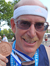 Ken with his miracle medal from 2009 Lahti worlds.