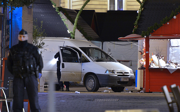Bomb disposal unit inpect the van a driver used to plough into a Christmas market injuring at least ten people before stabbing himself in the western French city of Nantes on December 22, 2014.
