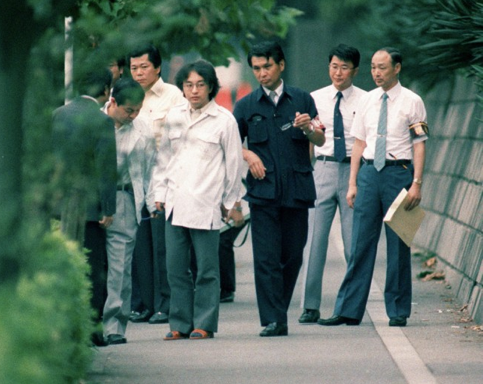 Not long after his capture, Miyazaki guides police in their investigation of his crimes.