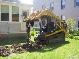 Skid steer post hole