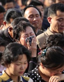 """In this Saturday, May 17, 2014 photo, families of victims of an accident at an apartment construction site in Pyongyang, North Korea, grieve during a gathering in the capital where senior officials apologized and took responsibility. The word of the collapse in the secretive nation's capital was reported Sunday morning, May 18 by the North's official Korean Central News Agency, which gave no death toll but said that the accident was """"serious"""" and upset North Korea's leader, Kim Jong Un. (AP Photo/Jon Chol Jin)"""