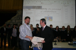 Dr Posluschny presents a pack to Balla No Name Club volunteer, Brendan Conwell. Image: Philippa Barry 2013