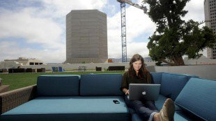 Jenna Sampson, a community relations manager at Twitter, works on the company's rooftop deck in San Francisco