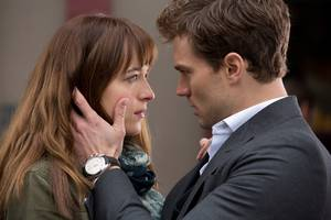 Jamie Dornan as Christian and Dakota Johnson as Ana Steele in Fifty Shades of Grey