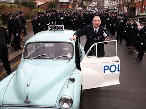 13 February 2015: PC Robert Brown, arrives by vintage car at Croydon Police station in south London, the country's longest serving officer is retiring after 47 years of service, he was greeted by a guard of honour by colleagues, including officers from Croydon and the Met's Dog unit