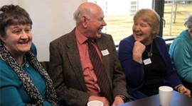 Parkinson's UK local group members having coffee at gathering in Stirling