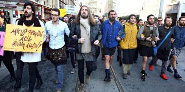 Men don skirts in İstanbul march to protest violence against women